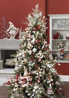 RAZ 2013 Christmas Trees - silver bells, red and silver elves and poinsettias. Lots of glitter and shine. VIsit us at Trendy Tree were we sell all sorts of RAZ Christmas decorations and much more! http://www.trendytree.com #TrendyTree #ChristmasTree