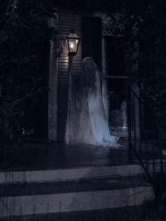 If I ever live in a house as opposed to an apartment, I will have a ghostly lady like this holding a lantern on my porch year round.