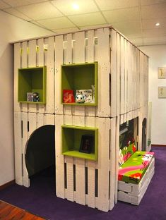 Kids' playroom made from wooden pallets.