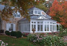 A Colonial Stone House With A Traditional Conservatory
