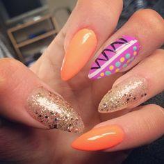 Fun unique pointy stiletto nails for prom