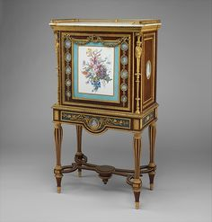 Drop-front desk (secrétaire à abattant or secrétaire en cabinet), Attributed to Adam Weisweiler (French, 1744–1820), Oak veneered with burl thuya, amaranth, mahogany, satinwood, holly, and ebonized holly; painted metal; one soft-paste porcelain plaque; fifteen jasper medallions; gilt-bronze mounts; marble; leather (not original), French, Paris and Sèvres