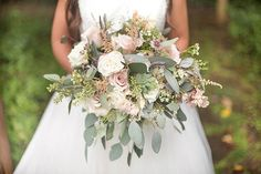 Designed by LB Floral, the leafily beautiful bridal bouquet consisted of seeded eucalyptus, succulents, lavender sprigs, and an assortment of baby-pink blooms. | Photo by Jewels Photography