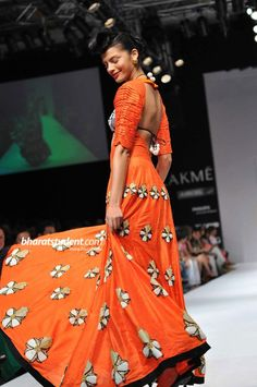 Gota Patti Flowers on Orange Lehenga. Simple. Pretty. Masaba