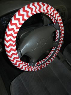 Just bought this for my mom van!!!   Red and White Chevron Steering Wheel Cover. $15.00, via Etsy.