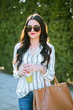 Red lipstick, striped blouse and oversized sunglasses for spring...