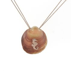 Sigal Gerber Jewelry shell necklace | 18k rose gold seahorse with a diamond on a rose gold double chain. #ocean www.sigalgerber.com