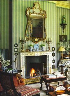 Room of the Day ~ striped walls, floral skirted table, miniatures, blue and white porcelain and a warm fire in Roger Banks-Pye sitting room 1.25.2015