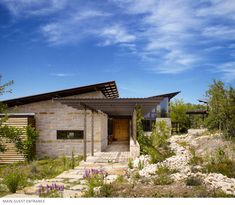 This 3,600 square feet home in Leon Springs, Texas is LEED Platinum-certified and features several affordable green building strategies that contribute to its net-zero water use. The homeowners asked architect Karla Greer (of Lake Flato Architects of San Antonio, Texas) for a sustainable home that celebrated nature and provided space for entertaining and energy-efficient living. Sustainable features include a 17,000-gallon rainwater catchment system. Water is triple-filtered to meet 100…