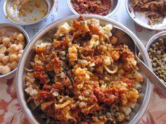 Koshary: rice, pasta, lentils, tomato sauce, chickpeas.