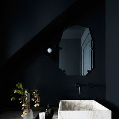 powder room is situated partially beneath the staircase, they were faced with the challenge of disguising both a sloped ceiling and some seriously awkward angles. Paint it black. A bronze and marble vanity was added as a crowning touch. Rooms With Slanted Ceilings, Angled Ceilings, Sloped Ceiling, Black Powder Room, Room Under Stairs, Powder Room Design, Interior Shutters, Apartment Makeover, Black Ceiling