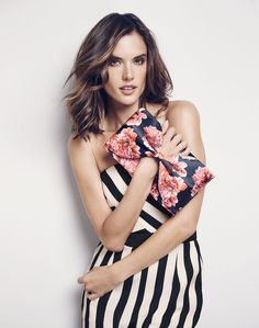Holding on to a floral print clutch, Alessandra Ambrosio models a striped dress for Coast Summer Icons 2016 campaign