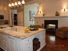 Kitchen with 2 sided fireplace to formal living room
