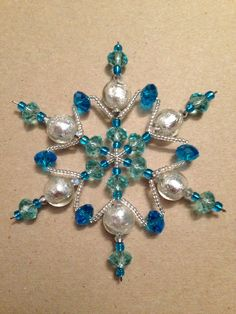 Pretty Homemade Snowflake Ornaments :: Best home design ideas Christmas Ornaments To Make, Snowflake Ornaments, Christmas Snowflakes, Beaded Ornaments, Christmas Jewelry, Christmas Crafts, Christmas Decorations, Beaded Snowflake, Decoracion Navidad Diy