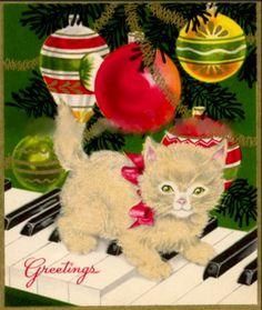 Christmas kitty among the ornaments.