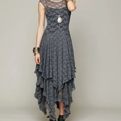 Bohemian lace dress stunning layered nwot This dress is so pretty so far I only have it in the charcoal gray shown but I do have more colors coming soon it's a size large would best fit a woman size 6-8 would also work as well you will need a full  length  slip because it's lace from head to toe it's a long dress about ankle length and I'm 5.6  this is a new item and will come wrapped nicely to give as a gift or a treat for yourself. More pictures upon request. Boho Dresses Maxi