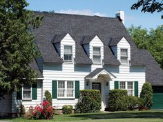 Cape Cod They were inspired by Britain's thatched cottages, but built with steeper roofs and larger chimneys to withstand cold Northeastern winters. Windows flanking the front door, dormer windows up top and cedar shingles are also typical of the style. Cape Cod Style House, Cottage Style House Plans, Cottage Style Homes, Country Homes, Zaha Hadid, Style At Home, Dormer Windows, Residential Architecture, Cultural Architecture