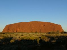 f one has to name a natural landmark in Australia, there cannot to more famous a name than Ayers Rock or Uluru. Located in the Northern Territory (Central Australia) this sacred sandstone rock formation is unique being one of the world's largest monoliths having a height of more than 318 metres or nearly 1000 feet. Measured at its base, a trip round the rock would be around 9 kms and marked with its colour changing at sunset and sunrise.