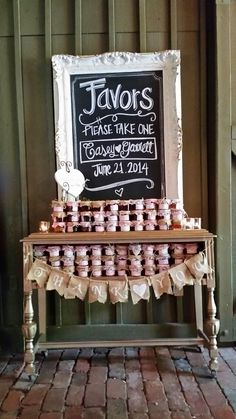 Rustic Elegance! @vinewoodevents created a fabulous favor table for a summer wedding using Southern Vintage gold sideboard. Rent from Southern Vintage in Macon Georgia.