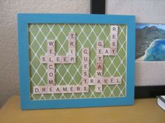 """DIY Scrabble Art.  This uses words like """"Welcome"""", """"Guests"""", """"travel"""" for the guest room!"""