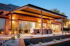 Modern / contemporary desert / arid patio in Phoenix - By: Lindsey Schultz Design - Brick exterior with corrugated metal roof and Cort-ten steel walls