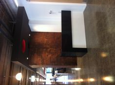 Woods fitout, Newmarket Auckland Metalier.co.nz rust finish on wall behind