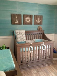 Create a gender neutral nursery with browns and turquoise. Adding a flair of sea related items will give this space a great nautical theme.