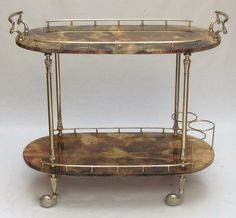 On-trend drinks cart! A chestnut lacquered goatskin and brass two tier trolley by Aldo Tura, Italian circa 1950, with L&V Art and Design.