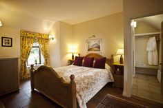 Rose Cottage master bedroom with luxury en-suite bathroom.