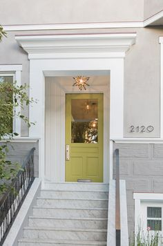 I love the front door color! And be still my heart, what a light fixture!!