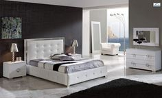 Contemporary Spain made luxurious bedroom set in white leather. This white bedroom set will help you bring sophisticated sense of style into your bedroom decor with its unique design features and European quality. This bedroom set offers an elegant blend of traditional elements with modern simplicit...