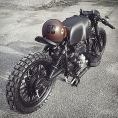 Our latest custom motorbike crush is this beastly beamer by Denmark's Relic Motorcycles. The donor bike started as a BMW R100S (it was actually an old police bike) from the 80s, and was striped to its essentials. The old rear section of the frame was