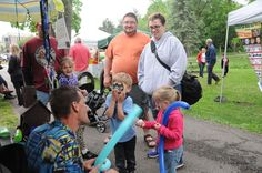 A local family enjoying the balloon twisters at week 1 of concerts in the park 2015