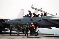 F14 pilots exiting their plane.