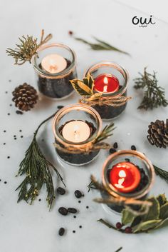 Say Oui to holiday candle holders with all the pretty touches. To make, tie twine rosemary, pine or holly to the outside of a clean pot of Oui by Yoplait. Fill with coffee beans and a tea light. Festive and simple. Glass Tea Light Holders, Glass Candle Holders, Candle Jars, Glass Jars, Christmas Jars, Diy Christmas Gifts, Holiday Crafts, Christmas Table Decorations, Centerpiece Decorations