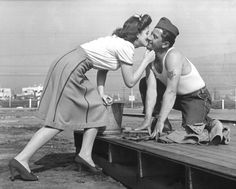 """MEET THE ACTRESS WHO SET OUT TO KISS 10,000 SOLDIERS TO BOOST MORALE....1942.. Marilyn Hare. """"A tent-floor scrubber sticks his neck out and recieves a right and a lip to the jaw. 'Now I won't mind if I kick the bucket,' cried he as he rose and upset his scrub pail."""""""