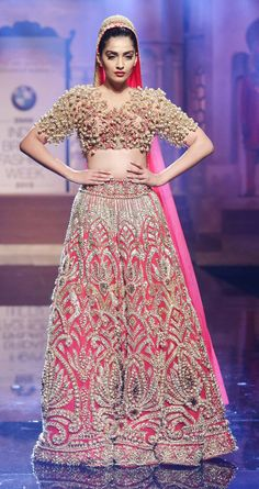 Sonam Kapoor in a Abu Jani and Sandeep Khosla golden gown at the India Bridal Fashion Week