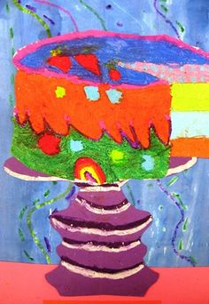 Second Grade Students created theses great Wayne Thiebaud inspired cakes by drawing a cylinder and learning to cut out a slice using parallel lines. The artwork was colored with oil pastels. Some students practiced blending too. Next, students make a symmetrical cake plate and added more oil pastel for value. Our backgrounds were made by making line designs with oil pastel and painting over it with watercolor paint. The oil pastel creates a resist. The students achieved a relief, or…