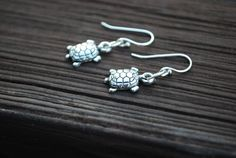 https://www.etsy.com/listing/84326242/silver-turtle-earrings-little-silver?ref=shop_home_active_4