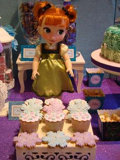 Anna doll and treats at a Frozen birthday party! See more party planning ideas at CatchMyParty.com!