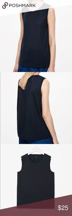 COS Navy Relaxed Sleeveless Top Size S Brand New Never worn, brand new! A relaxed style, this sleeveless top is made from extra-soft jersey with a smooth, fluid quality. Designed to fall loosely on the body, it has a wide round neckline, deep ribbed armholes and a neat topstitched hem. Back length of size Small is 66cm / 100% Lyocell / Delicate Cycle. COS Tops Muscle Tees