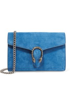 Part of the cult 'Dionysus' family, Gucci's butter-soft blue suede shoulder bag is constructed like a wallet, with card and bill slots and a zipped compartment. It's decorated with the house's signature tiger head clasp and has a chain strap – we love how you can detach it to carry this style as a clutch.