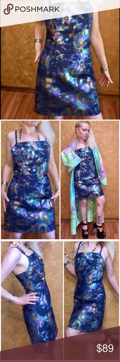 "oil slick holographic dress iridescent rainbow ⚡️🍭 ELECTRIC DRESS oil slick beauty all over this dress! EXCELLENT CONDITION ready to wear! The fabric is a stretchy denim with thick oil slick print. Size M Bust 32""-36"" waist 28""-30"" hip 34""-40"" relaxed then stretched. Length 23"". Glow at the disco baby✨🍭 Kimono &  shoes listed separately. Club kid unif lip service wildfox Gothic vampire dress dollskill  hippie 70s pastelgoth current mood Jeffrey Campbell cyberdog Betsey Johnson Alley cat…"