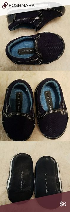 BABY BOY crib shoes Super cute navy blue slide on Elie Tahari sneakers. Gently worn still in good condition😊  FLAWS: .Adhesive marks on the botton from the price tag..( see pic #3) Elie Tahari Shoes Sneakers