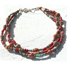 multi-strand necklace, turquoise howlite heishi, glass from Indonesia, gorgeous richly colored paper beads,copper, gift bag. $68.00, via Etsy.