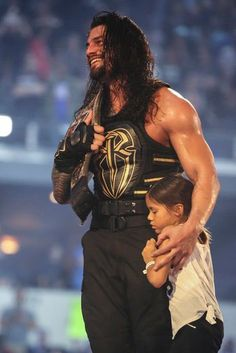 Roman after winning the WWE Championship in his 2nd consecutive Mania Main Event