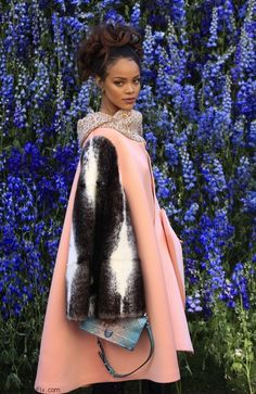 Rihanna wearing oversized pink coat with cape shape from Dior Fall 2015 Couture collection at the Christian Dior Spring-Summer 2016 Fashion Show during Paris fashion week spring 2016 (October 2015). #rihanna #dior