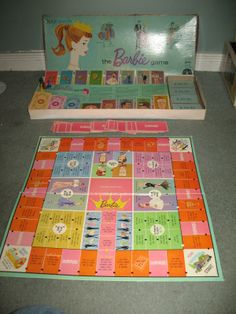 Vintage 1960s Barbie Queen Of The Prom Shopping Board Game By Mattel - Played this all of the time with my sister. I bought a remake of it years ago, and now my granddaughter likes to play the game with me.