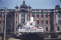 Welcome banner for UN at new UN Headquarters in former Japanese Viceroy's offices, 1949 Seoul. Photo is lightened from original (link).