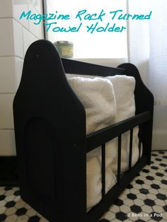Magazine Rack turned Towel Holder with black chalk paint. We freed up precious closet space by adding our bath towels to this rack.